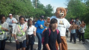 Safety Bear walking with the students!